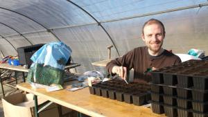 Keith in the polytunnel on the Happy Farm, Plum Village
