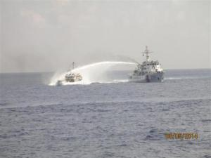 A Chinese ship (R) uses water cannon on a Vietnamese Sea Guard ship on the South China Sea near the Paracels islands, in this handout photo taken on May 5, 2014 and released by the Vietnamese Marine  Credit: REUTERS/Vietnam Marine Guard/Handout via Reuters